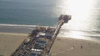 DCLA_123 - 5K stock footage aerial video of orbiting Santa Monica Pier on the beach in Los Angeles, California