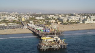 DCLA_126 - 5K stock footage aerial video orbit end of Santa Monica Pier with visitors in Los Angeles, California