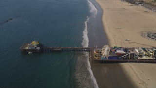 DCLA_127 - 5K stock footage aerial video orbit visitors and rides at Santa Monica Pier in California
