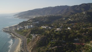 DCLA_134 - 5K stock footage aerial video bird's eye view of Highway 1 and tilt to reveal hilltop homes in Pacific Palisades, California
