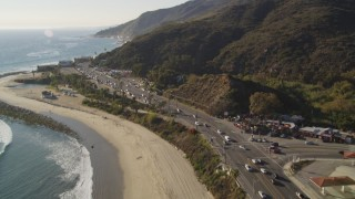 DCLA_139 - 5K stock footage aerial video tilt from Highway 1 and beach to Malibu, California