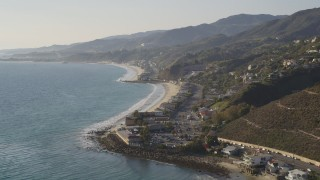 DCLA_145 - 5K stock footage aerial video tilt from ocean to reveal the coastal community of Malibu, California