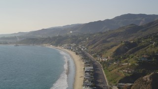DCLA_146 - 5K stock footage aerial video pan from coastal foothills to beachfront homes in Malibu, California