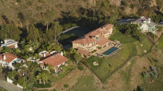 DCLA_147 - 5K stock footage aerial video orbit hilltop mansion in Malibu, California