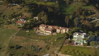 DCLA_149 - 5K stock footage aerial video of reverse view of a hilltop mansion in Malibu, California
