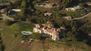DCLA_151 - 5K stock footage aerial video orbit mansion on a hill in Malibu, California