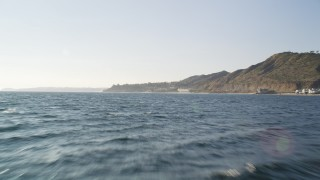 DCLA_160 - 5K stock footage aerial video tilt from the blue ocean to reveal and approach the coast of Malibu, California