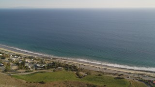 DCLA_163 - 5K stock footage aerial video fly over mountain to reveal and approach Highway 1 in Malibu, California