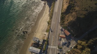DCLA_164 - 5K stock footage aerial video of bird's eye view of Highway 1 and side road in Malibu, California