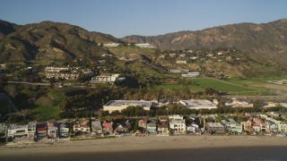 DCLA_171 - 5K stock footage aerial video of beachfront homes and hilltop homes in Malibu, California