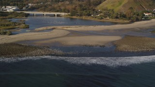 DCLA_172 - 5K stock footage aerial video of flocks of birds by the beach in Malibu, California
