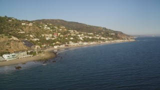 DCLA_175 - 5K stock footage aerial video of homes by the beach and on hillsides in Malibu, California