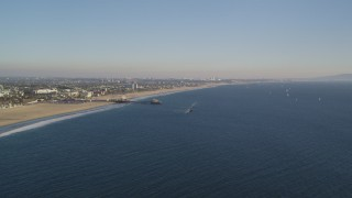 DCLA_179 - 5K stock footage aerial video of slow approach to Santa Monica Pier and the beach in California