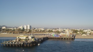 DCLA_181 - 5K stock footage aerial video fly near the end of Santa Monica Pier with rides in California