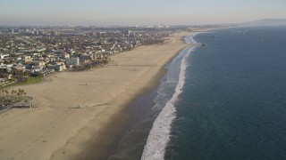 DCLA_182 - 5K stock footage aerial video approach and fly over the beach by Venice, California