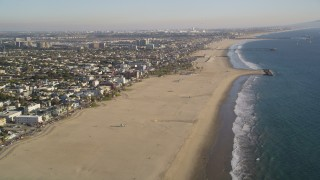 DCLA_183 - 5K stock footage aerial video tilt from beach and follow the coast of Venice, California