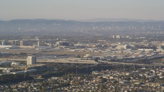 DCLA_202 - 5K stock footage aerial video of Interstate 405/105 freeway interchange by LAX Airport, California