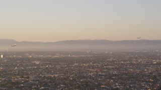 DCLA_203 - 5K stock footage aerial video track two airliners approaching Los Angeles International Airport, California