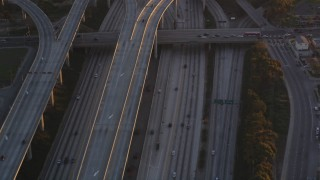 DCLA_205 - 5K stock footage video of freeway interchange between I-110 and 105 in Westmont at sunset, California