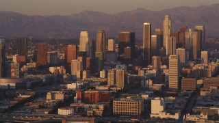 DCLA_209 - 5K stock footage aerial video flyby Downtown Los Angeles skyscrapers at sunset, California