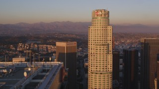 DCLA_213 - 5K stock footage aerial video tilt from Hope Street to approach Aon Center and US Bank Tower at sunset in Downtown Los Angeles, California
