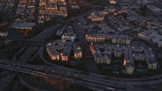 DCLA_215 - 5K stock footage aerial video fly over Downtown Los Angeles concert hall and theater near freeway and apartments at sunset, California