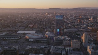 DCLA_223 - 5K stock footage aerial video of Staples Center and The Ritz-Carlton in Downtown Los Angeles at sunset, California