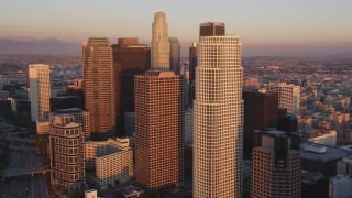 DCLA_227 - 5K stock footage aerial video tilt from heavy traffic on Highway 110 to reveal and approach Downtown Los Angeles at sunset, California