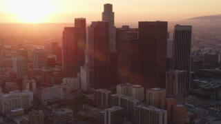 DCLA_232 - 5K stock footage aerial video tilt to reveal city hall and Downtown Los Angeles skyline at sunset, California