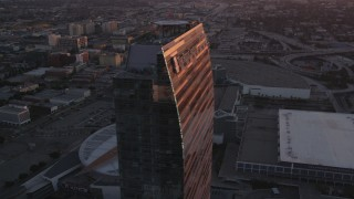 DCLA_236 - 5K stock footage aerial video orbit Ritz-Carlton and Staples Center in Downtown Los Angeles at sunset, California