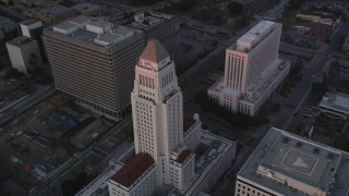 DCLA_241 - 5K stock footage aerial video orbit Los Angeles City Hall at twilight in Downtown Los Angeles, California
