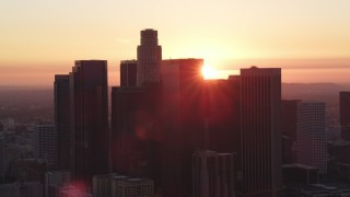 DCLA_243 - 5K stock footage aerial video of Downtown Los Angeles skyline silhouetted by the setting sun, California