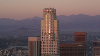 DCLA_247 - 5K stock footage aerial video reverse view of US Bank Tower at sunset in Downtown Los Angeles, California