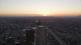 DCLA_253 - 5K stock footage aerial video fly over Downtown Los Angeles toward setting sun in California