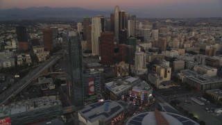 DCLA_255 - 5K stock footage aerial video of Downtown Los Angeles high-rises seen from The Ritz-Carlton at twilight, California
