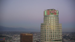 DCLA_264 - 5K stock footage aerial video approach top of US Bank Tower at twilight in Downtown Los Angeles, California