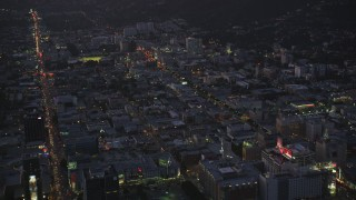DCLA_275 - 5K stock footage aerial video approach Hollywood with bright lights on city streets at twilight, California