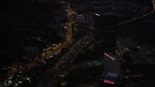 DCLA_286 - 5K stock footage aerial video of light Highway 101 traffic in Universal City at night, California