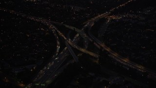 DCLA_288 - 5K stock footage aerial video approach Hollywood Split freeway interchange at night in North Hollywood, California