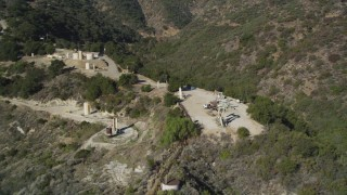 DCSF01_002 - 5K stock footage aerial video Flying by oil rigs in the hills, Santa Paula, California