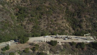 DCSF01_003 - 5K stock footage aerial video Orbiting oil rigs in the hills, Santa Paula, California