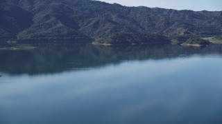 DCSF01_006 - 5K stock footage aerial video Flying by the still water of Lake Casitas, Ventura, California