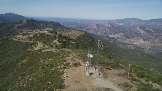 DCSF01_010 - 5K stock footage aerial video Cell phone tower, antenna arrays atop mountain ridge, Santa Ynez Mountains, California