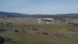 DCSF01_017 - 5K stock footage aerial video Approaching Santa Ynez Airport for a landing, Santa Ynez, California