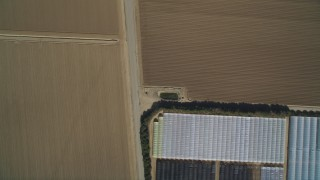 DCSF02_002 - 5K stock footage aerial video Bird's eye view over dry riverbed, reveal greenhouses and farmland, Nipomo, California