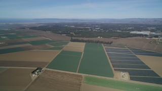 DCSF02_003 - 5K stock footage aerial video Flying over geometric farmland, Nipomo, California