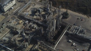 DCSF02_007 - 5K stock footage aerial video Tilt to bird's eye of flare stacks and structures at Phillips 66 Company Santa Maria Refinery, Arroyo Grande, California
