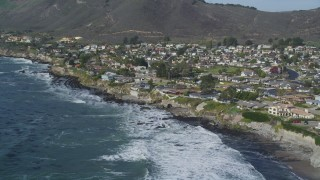 DCSF02_011 - 5K stock footage aerial video Flying over rolling waves by oceanfront homes, Shell Beach, California