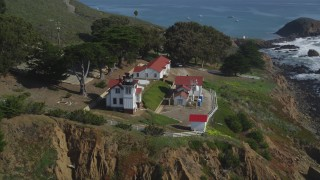 DCSF02_016 - 5K stock footage aerial video Orbit San Luis Obispo Lighthouse on a cliff overlooking the ocean, San Luis Obispo, California