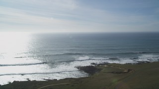 DCSF03_007 - 5K stock footage aerial video Flying by the Pacific Ocean, seen from the coastline, Harmony, California